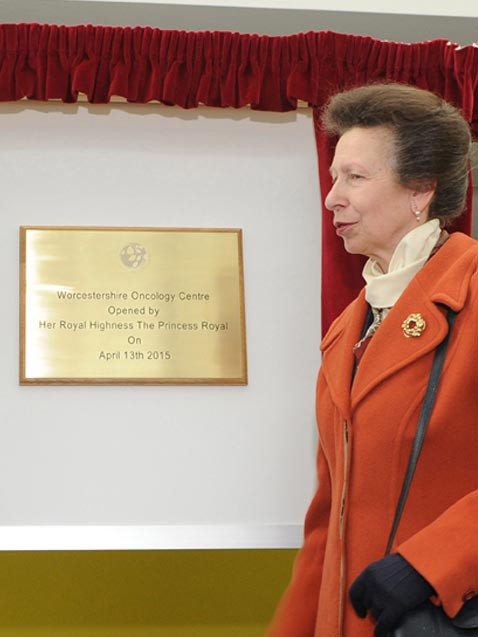 engraved brass plaque at unveiling ceremony